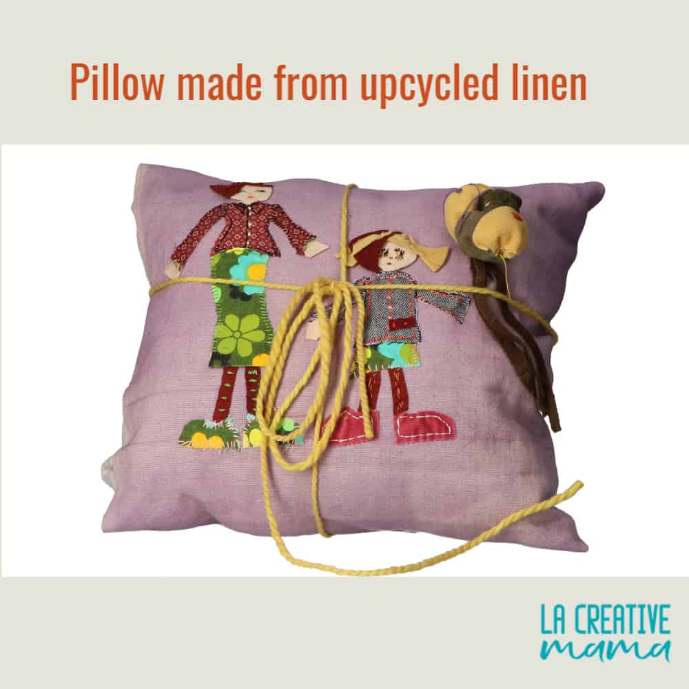 upcycled linen made into an envelope pillow using embroidered patches