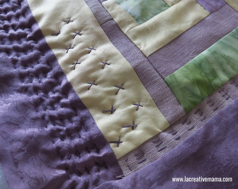 natural dyes on silk transformed into a mini simple quilt using the log cabin block
