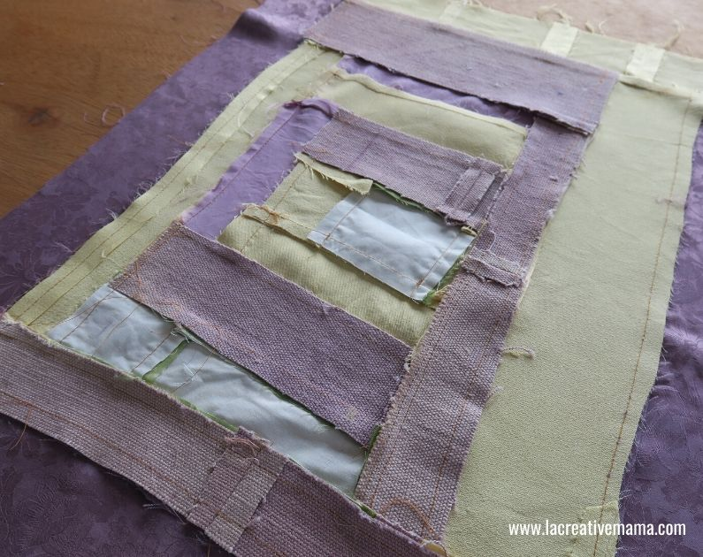 a simple quilt using a log cabin quilting block from the underside for you to see the seams