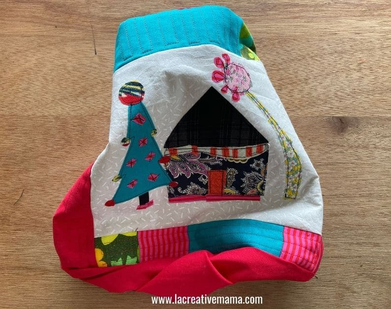 flipping the quilted Christmas pillow inside out