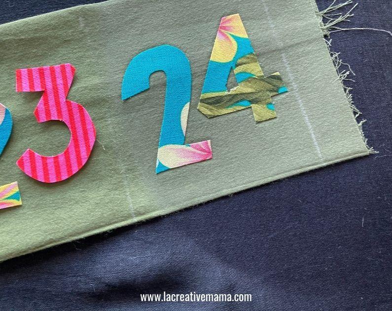 ironing the iron on fusing applique on fabric advent calendar pocket