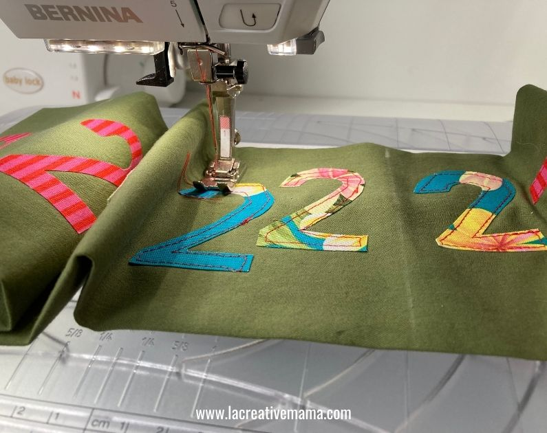 sewing the iron on fusing applique on fabric advent calendar pocket
