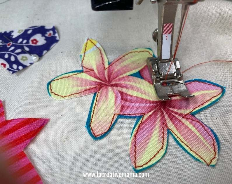 sewing around the applique pattern