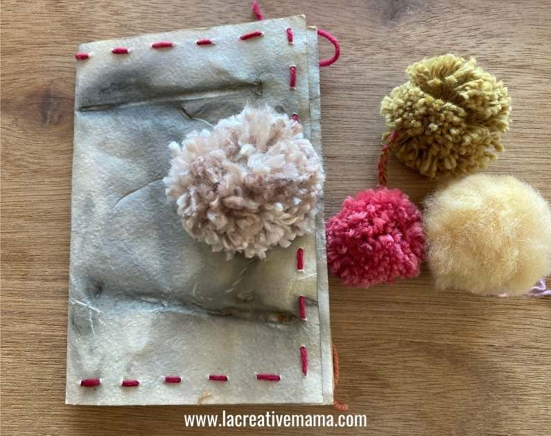 pom poms to finish and close the eco print paper book