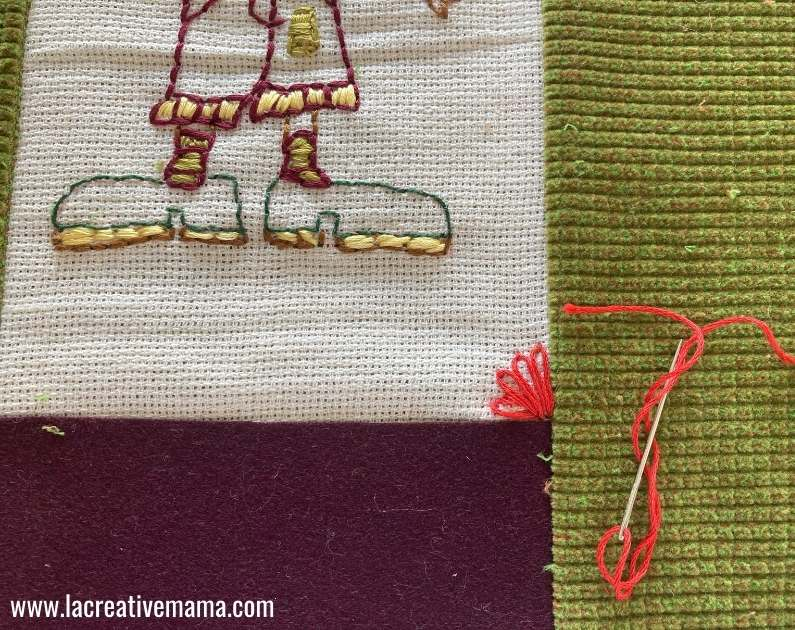 embroidering a lazy daisy stitch on the pillow cover