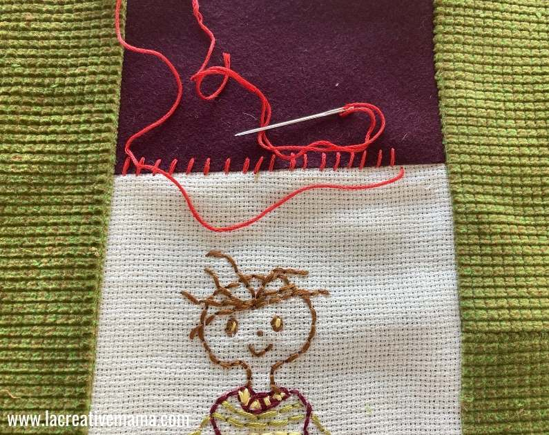 embroidering a whipstitch on the pillow cover
