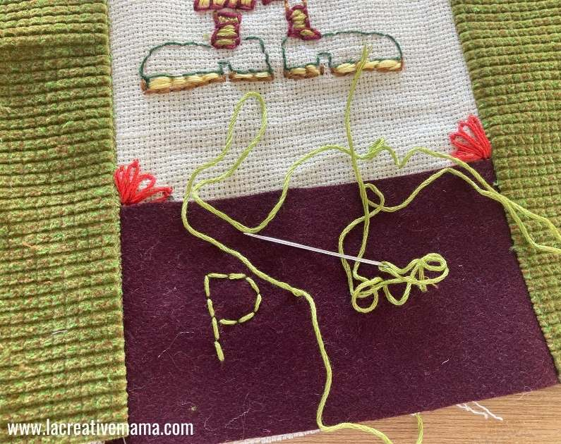 personalized pillow cover by embroidering a name using a backstitch