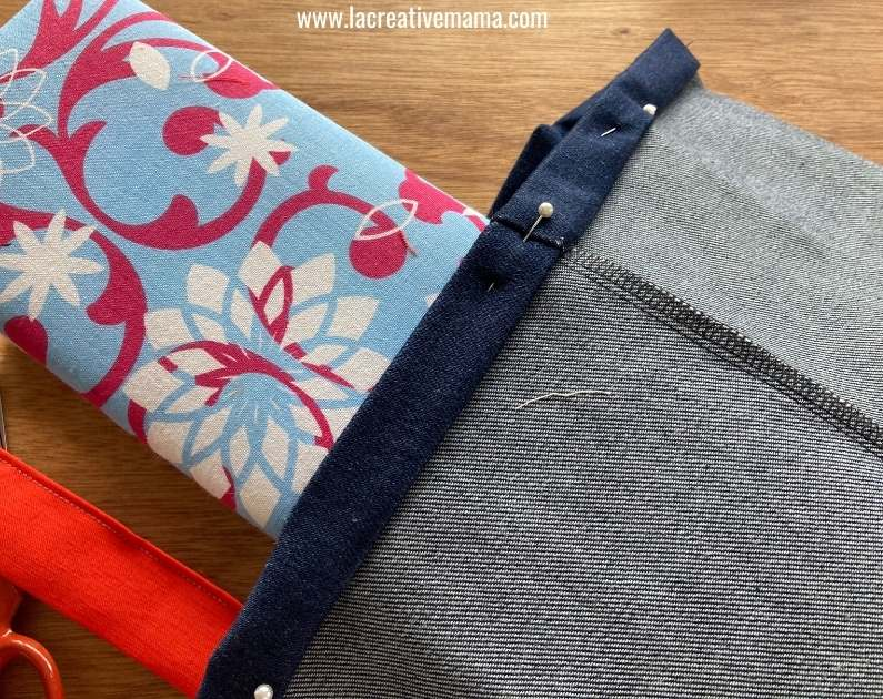 hemming the top edge of the tote bag