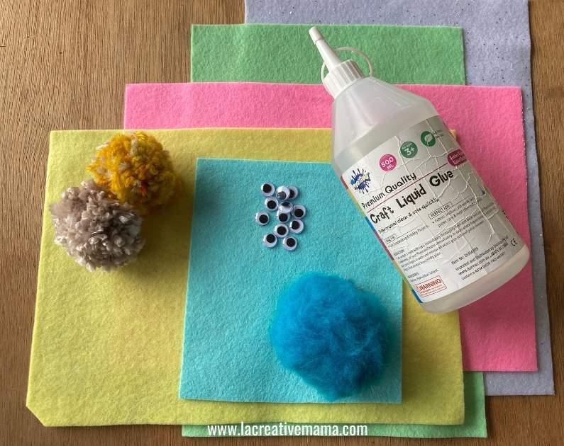felt fabric, pom poms, and glue to make pom pom animals