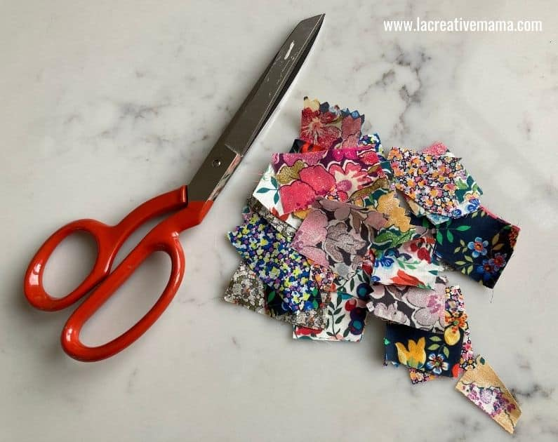 cutting fabric scraps to decorate easter eggs using fabric