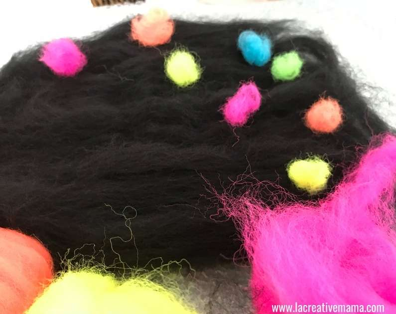 laying the layers of wool roving to wet felt