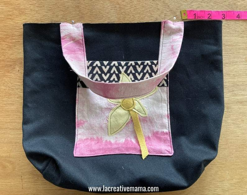 sewing the straps to the bag