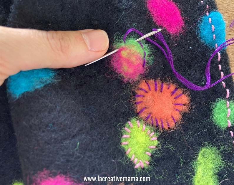 decorating a  piece of felt with embroidery stitches