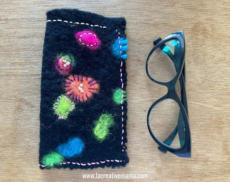 embroidery on felt fabric that makes a glasses pouch