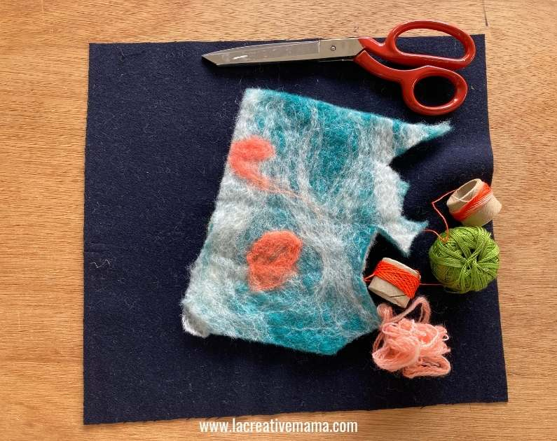 wet felted wool  fabric and embroidery threads.