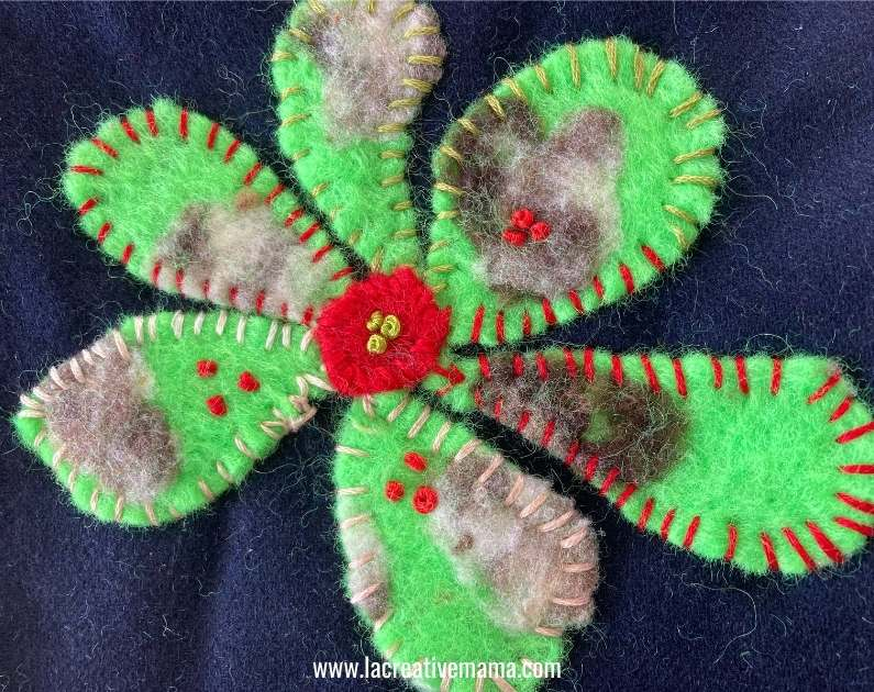 applying felt flowers using embroidery stitches tutorial