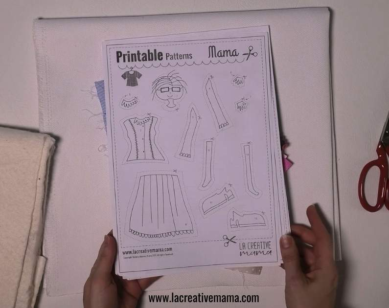 tracing the applique pattern from la creative mama free resource library to make fabric applique