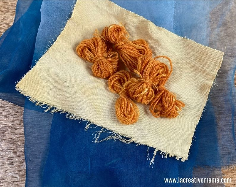 fabric dyed with indigo and silk and wool dyed using onion skins